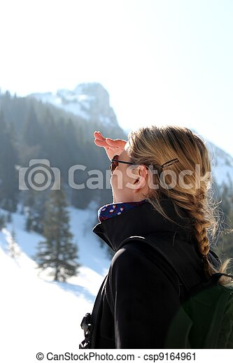 Woman looking up on a mountain - csp9164961