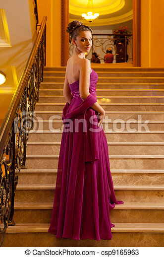 woman in a long dress lying on the stairs - csp9165963