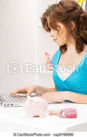 lovely woman with piggy bank and money - csp9166890