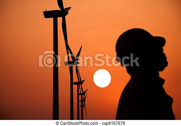 The Silhouette of windmills worker with  sunset - csp9167678