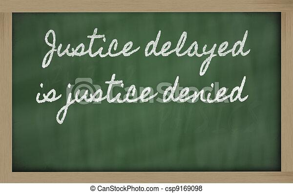 handwriting blackboard writings - Justice delayed is justice denied - csp9169098