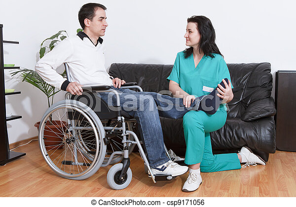 Physical therapist working with patient - csp9171056