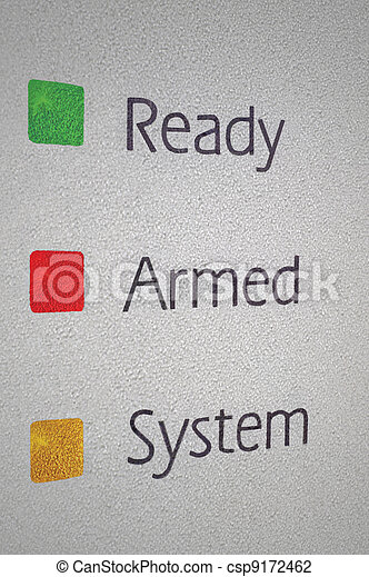 Armed home security alarm system panel macro closeup, green, red, yellow ready set signal lights - csp9172462