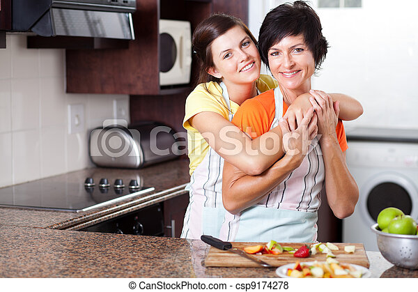 middle aged mother and teen daughter - csp9174278