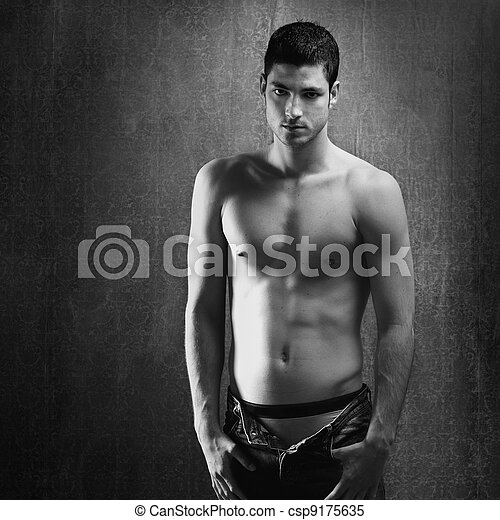 Black and white sexy young denim shirtless man - csp9175635