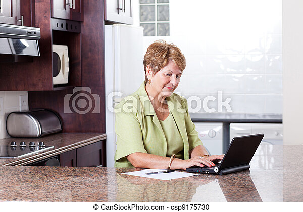 senior woman using internet banking - csp9175730