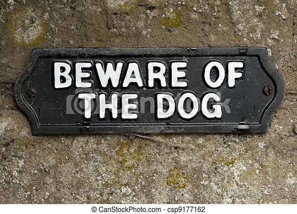 Beware of the dog sign screwed onto stone - csp9177162