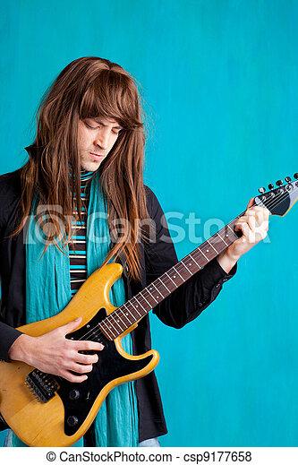 Hard rock seventies electric guitar player man - csp9177658