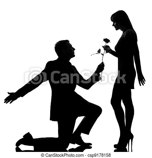 one couple man kneeling offering rose flower and woman smiling - csp9178158