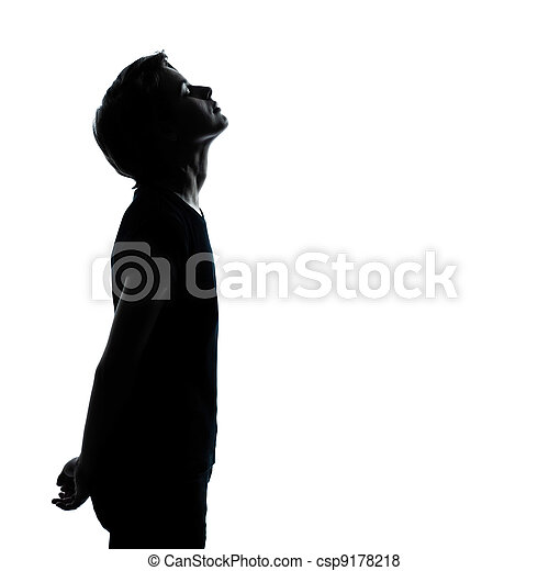 one young teenager boy or girl looking up silhouette - csp9178218