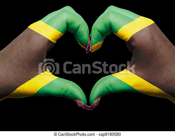 Tourist peru made by jamaica flag colored hands showing symbol of heart and love - csp9180580