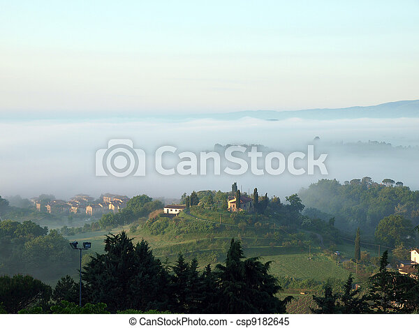 Fabulous landscape of the foggy morning in Tuscany. The valley between Montepulciano and Chiusi - csp9182645