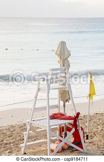 Lifeguard Stand on Beach with Yellow Caution Flag - csp9184711