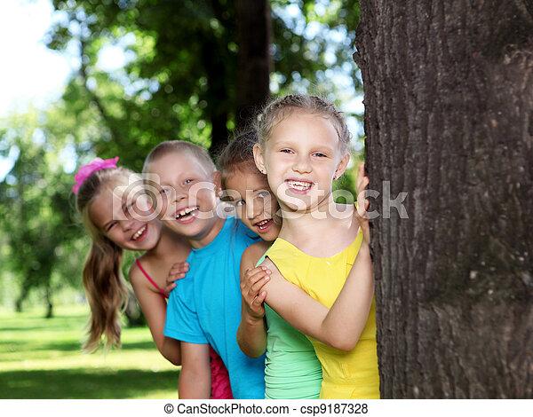 Children playing in the summer park - csp9187328
