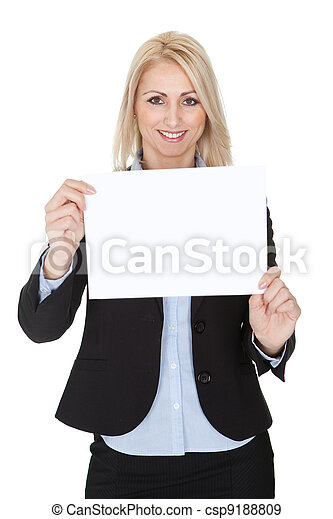 Cheerful businesswomen presenting empty board - csp9188809