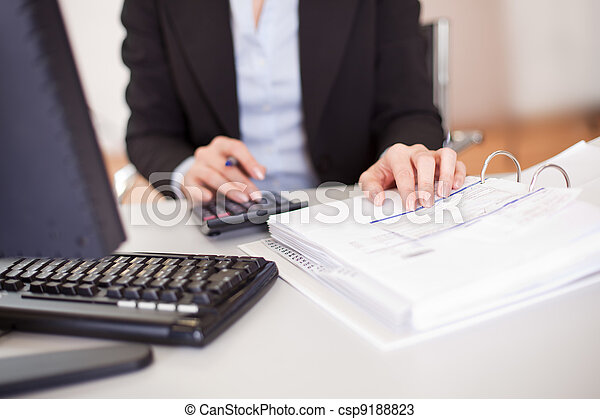 Closeup of a businesswoman doing finances - csp9188823