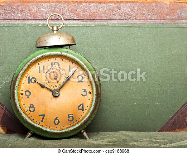 vintage clock with old book on background - csp9188968