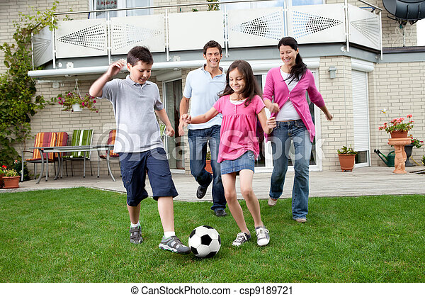 Happy family playing football in their backyard - csp9189721