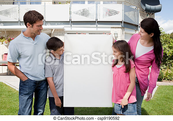 Family looking at a empty board outside house - csp9190592