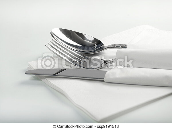 Spoon, fork and a knife lie on serviette - csp9191518