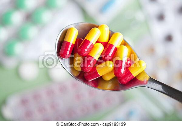 capsule pills in spoon