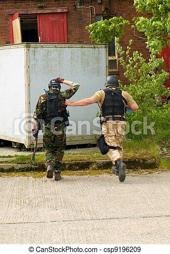 Soldier Escorting a captured combatant - csp9196209