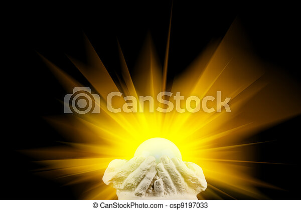 Spiritual light in cupped hands - csp9197033