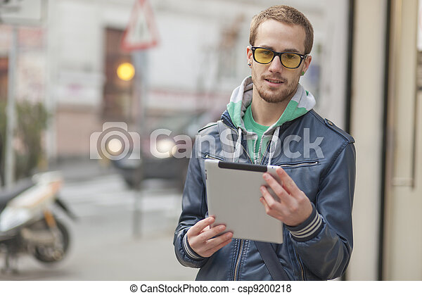Man On Street Use Ipad Tablet Computer - csp9200218