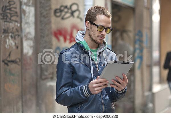 Man On Street Use Ipad Tablet Computer - csp9200220