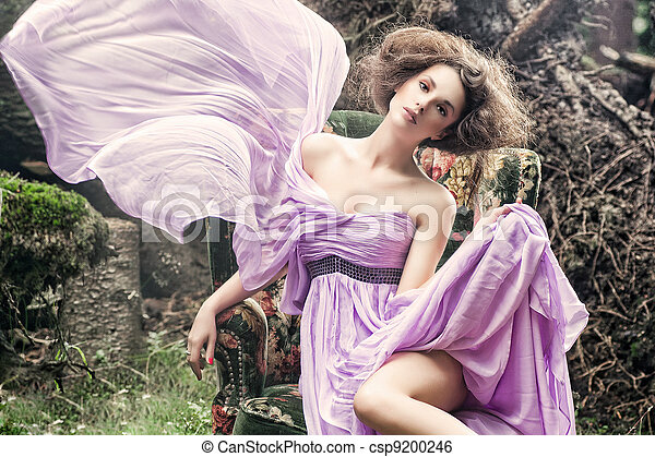 Glamorous woman sitting on a stylis - csp9200246