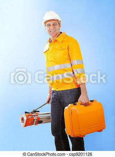 Senior land surveyor with theodolite equipment - csp9201126
