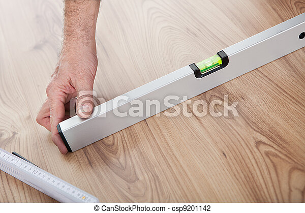 Worker working on laminate floor - csp9201142