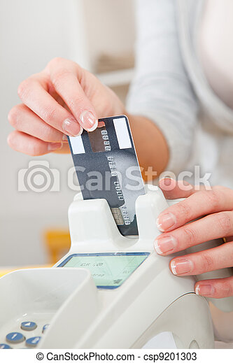 Sales person inserting card into scanner - csp9201303