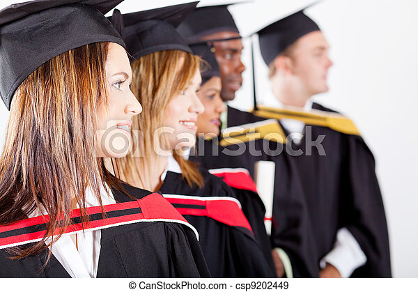 graduates looking away at graduation - csp9202449
