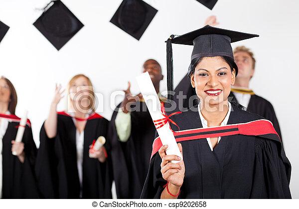happy female Indian graduate at graduation - csp9202658