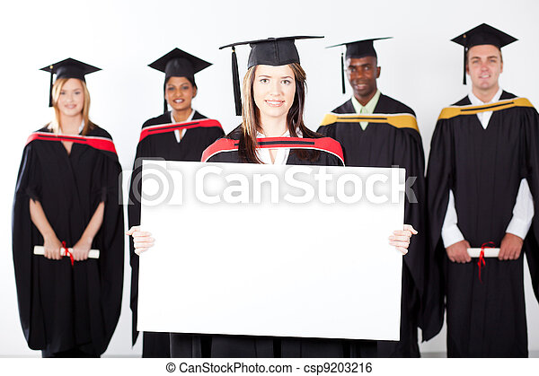 attractive graduate holding white board - csp9203216