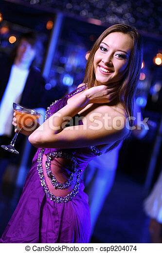 Young woman having fun at nightclub disco - csp9204074