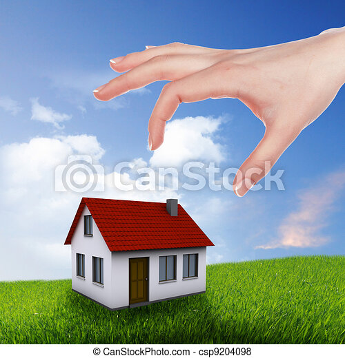 House and human hand against blue sky - csp9204098