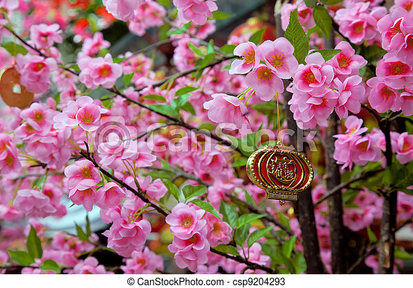 Chinese new year charm hanging from artificial cherry tree - csp9204293