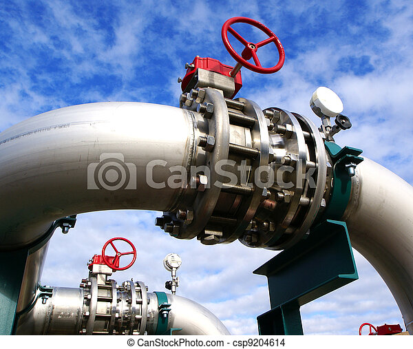Industrial zone, Steel pipelines and valves against blue sky - csp9204614