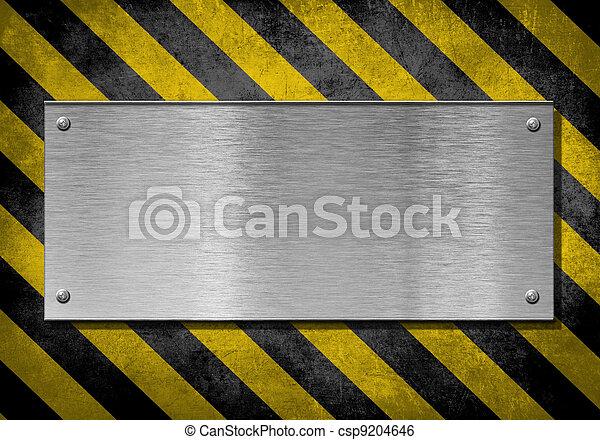 metal plate background with hazard stripes - csp9204646