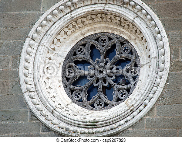 Rose window on the facade of the church of St. Margaret of Cortona - csp9207823