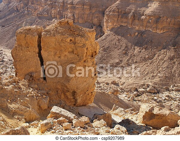 Scenic cracked orange rock in stone desert - csp9207989