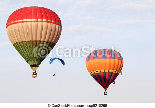 PUTRAJAYA, MALAYSIA-MAR 16: Hot Air balloon and paraglider in flight at the 4th Putrajaya International Hot Air Balloon Fiesta Mar 16, 2012 in Putrajaya. - csp9210266