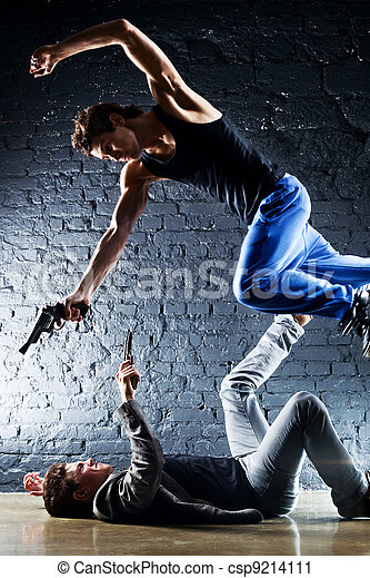 Men with guns fighting - csp9214111