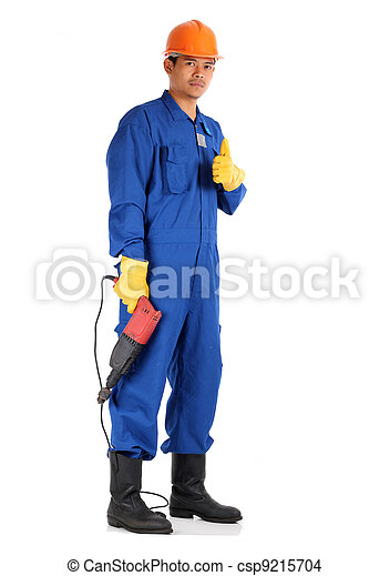 asian worker complete with personal protective equipment and electrical drill ready to work on safety concept - csp9215704