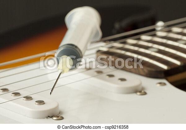 Syringe and guitar - csp9216358