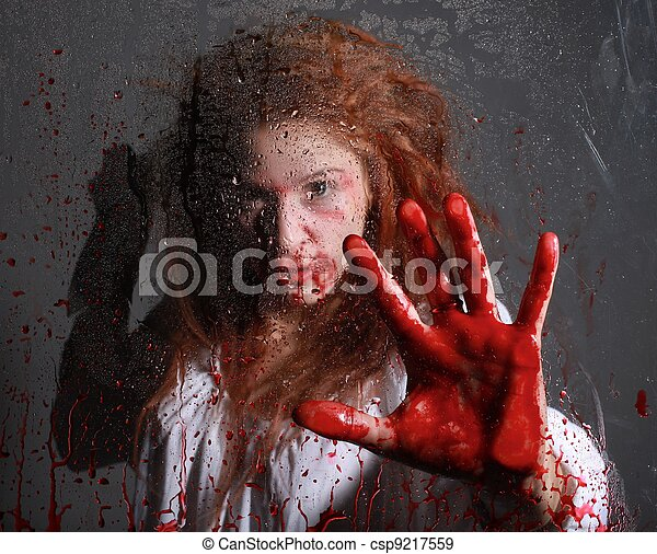 Horror Themed Image With Bleeding Frightened Woman - csp9217559