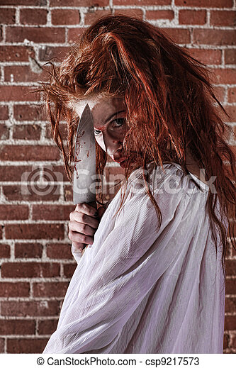 Horror Themed Image With Bleeding Frightened Woman - csp9217573