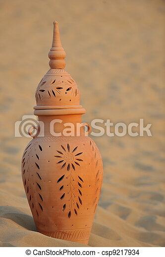arabic pot in sand